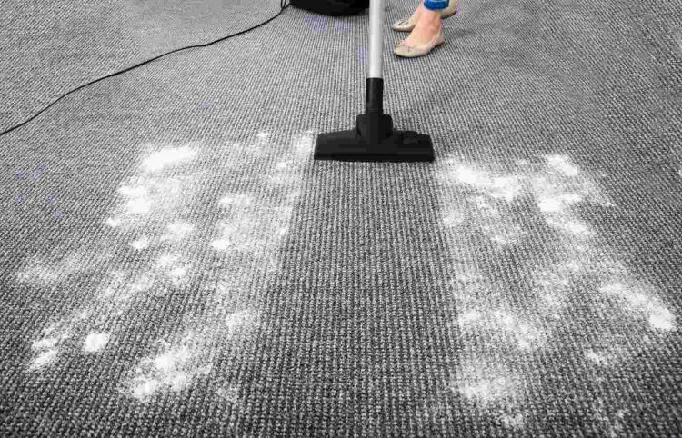 Vacuum Cleaner Cleaning Dirt On Carpet with powder
